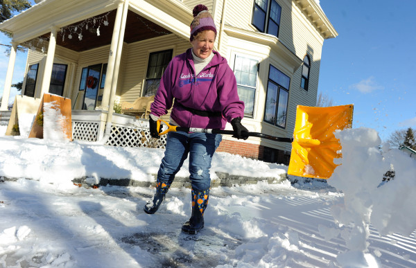 Sally Jones shovels her driveway on Friday in Bangor.