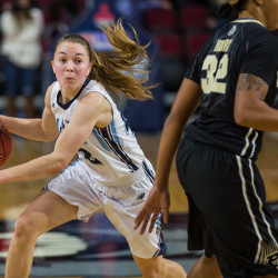 Senior Sigi Koizar of the University of Maine (left) pictured during a Nov. 11 game in Bangor, suffered an apparent leg injury in Friday's game at Boston College. The Eagles won 64-53.