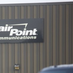 A FairPoint sign can be seen in Bangor in this August 2014 file photo.