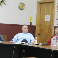 Madawaska's finance committee Chair Steve Collard (left) discusses the latest school budget proposal with fellow committee member Derrick Hebert on Monday in Madawaska.