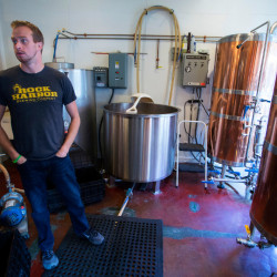 Rock Harbor Pub and Brewery owner Dan Pease shows off the brewery part of his brewpub in Rockland Thursday. Pease has bought a new building with hopes of a big expansion on their brewing this summer.