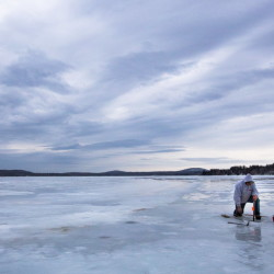 Gary Arsenault, 65, of Winterport packs up his ice fishing gear on Swan Lake, Jan. 25, 2016. The mild weather drew him out, but the fish weren't biting.