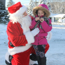 Isabelle Nichols, 4, of Fort Kent, visits with Santa Claus during a holiday celebration in Fort Kent.