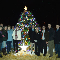 Among those taking part in the Lights of Life Tree Lighting Ceremony at Machias Savings Bank's community tree were, from left: Greg LaFrancois, TAMC president; Jeannie Fox, Ruel Flannery's niece; Dan Boyd, Ruel's son-in-law; Debi-Jo Bishop Wollard, Ruel's niece; Jill Boyd, Ruel's daughter; Brenda Baker, manager of TAMC's Aroostook Cancer Care; Gloria Flannery, Ruel's widow; from Machias Savings Bank, Michael Kelley, Jr., Renee Saucier, and Michael Kelley, Sr.; and from TAMC's executive leadership team, Joe Siddiqui, Tim Doak and Dr. Jay Reynolds.