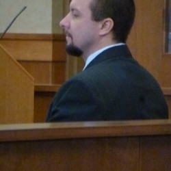 Matthew Davis of Houlton waits for his double murder trial to resume at the Washington County Judicial Center on Dec. 8.