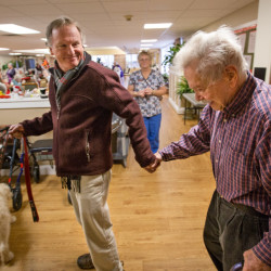 John Jemison of Orono leads his father, Jack Jemison, 94, to the dining room of the Phillip Strickland House assisted living facility in Bangor for lunch on Monday. Jack Jemison struggles with memory loss and the disorienting fallout of a couple of big, recent changes: the transition to Maine in 2014 from his lifelong home in Memphis, Tennessee, and the death of his wife of 60 years, Jan, earlier this year. For John Jemison, a professor of soil and water quality with the University of Maine Cooperative Extension, the day-to-day issue is largely one of finding enough time to spend with his recently widowed father.