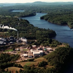 Aerial view of the HoltraChem Manufacturing Co., in Orrington, Maine which manufactured chlorine, caustic soda (sodium hydroxide) and chlorine bleach (sodium hypochlorite) used by paper mills. The plant also manufactured hydrochloric acid and the pesticide chloropicrin. The plant closed in September, 2000. http://maine.gov/dep/spills/holtrachem/site.html