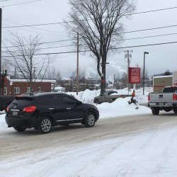Traffic entering and exiting the KMart Shopping Plaza in downtown Madawaska Thursday morning. The Town is concerned regarding lack of traffic signal lights along Main Street causing accidents.