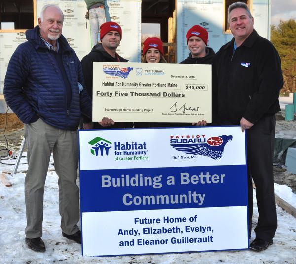 Patriot Subaru donates $45,000 to Habitat For Humanity/Greater Portland Maine.  L-R Godfrey Wood, Executive Director HFH/GP, with Patriot Subaru associates, Dustin Kimball, Kaitlyn Leavitt, Zack Smith, and Brian Beattie.