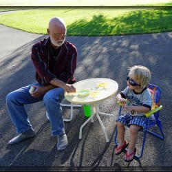Stu Craig of Mars Hill, esophageal cancer survivor, blows bubbles with grandson Conall.