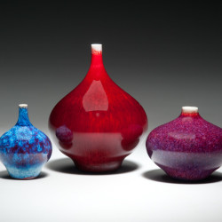 Three porcelain vases by Mark Bell.