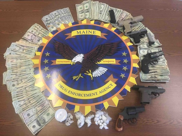 Guns, drugs and cash seized in a drug bust in Augusta on Tuesday.