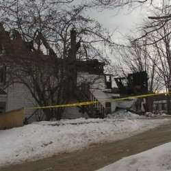 A Richmond man is in critical condition after a police officer pulled him out of a burning building on Christmas morning.