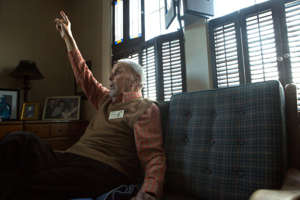 Phil Gouzie, 94, tells stories of his days in the Civilian Conservation Corps on the couch in his South Portland living room. he left Westbrook High School in his sophomore year to join the corps.