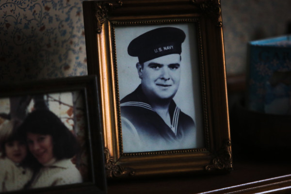 A WWII-era portrait from his time in the navy sits on Phil Gouzie's shelf in South Portland. The now 94-year-old served in the Civilian Conservation Corps before that.