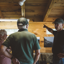 One of the artists in residence, Robert Pollien, talking to guests in his art studio.