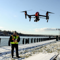 Vinal Applebee, chief unmanned aerial vehicle pilot for the Down East Emergency Medicine Institute, uses a drone to conduct a grid search of the Penobscot River shoreline from the Bangor Waterfront on Friday morning during efforts to find Paul Francis III, who went missing last Friday night from Bangor. Applebee was covering half to 1 mile of the shoreline, taking some 300 high-resolution photos to be analyzed.
