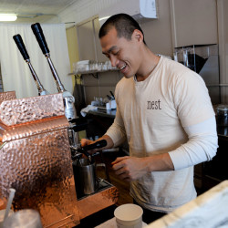 Li Yang, co-owner of the new coffee house Nest in Orono with Anna Berube, makes a latte.