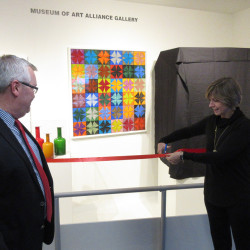 Joyce Clark Sarnacki, Bangor Savings Bank's Executive Vice President and Chief Customer Experience Officer, and George Kinghorn, UMMA Director and Curator, open the new Alliance Gallery at the December 15 ribbon-cutting ceremony.