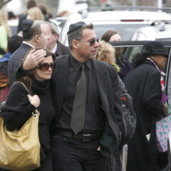 People leave the funeral services for Noah Pozner in Fairfield, Connecticut December 17, 2012. Pozner,6, was the youngest victim of the shooting at Sandy Hook Elementary School in Newtown, Connecticut.