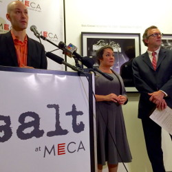 The Maine College of Art aquisition of the Salt Institute for Documentary Studies in April. MECA's dean Ian Anderson (left), addressed the crowd as Salt former board chair Kimberly Curry (center) and past president Donald Tuski looked on.