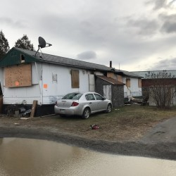 A mother and her son are in serious condition after a police officer pulled them from their burning mobile home Friday night, according to state fire marshals.
