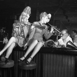'Two women try hard, but cannot seem to cheer up Jerry Therrien, bartender at the Copacobana in 1946'