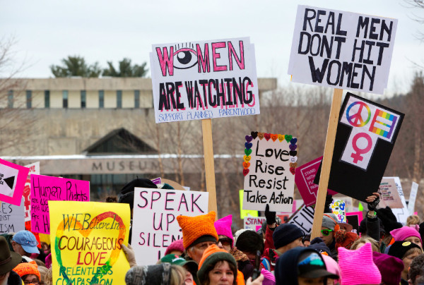 Supporters hold signs during the Women's March on Maine outside the Burton M. Cross building at the Maine State House in Augusta on Saturday. The national rally was in support of women's rights, civil liberties and protection of the planet.