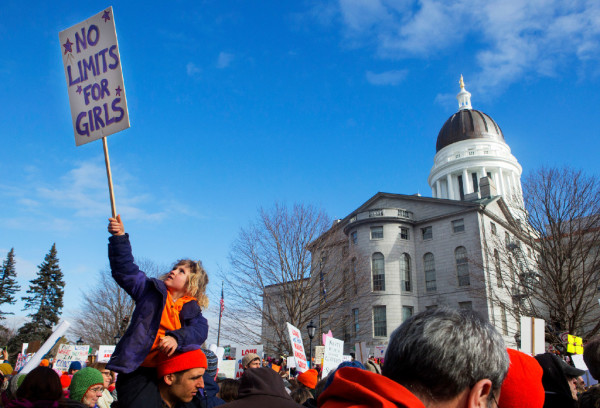 Ada Yentes-Quinn, 6, waves her sign in the air during the Women's March on Maine outside the Burton M. Cross building at the Maine State House in Augusta on Saturday. The national rally was in support of women's rights, civil liberties and protection of the planet.