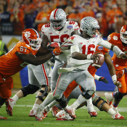 Clemson Tigers defensive tackle Albert Huggins (67) grabs the jersey of Ohio State Buckeyes quarterback J.T. Barrett (16) as he scrambles during the fourth quarter during the 2016 CFP semifinal at University of Phoenix Stadium.