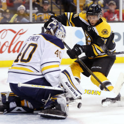 Boston Bruins center Ryan Spooner (51) looks for a rebound in front of Buffalo Sabres goalie Robin Lehner (40) during the second period at TD Garden on Saturday.