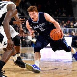 Maine Black Bears forward Andrew Fleming (0) drives to the basket against Providence Friars guard Isaiah Jackson (44) during the second half at the Dunkin Donuts Center on Dec. 20. The Friars won 79-59.