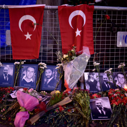 Flowers and pictures of the victims are placed near the entrance of Reina nightclub, which was attacked by a gunman, in Istanbul, Turkey, Jan. 2, 2017.