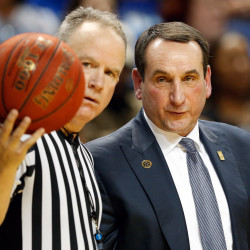 Duke head coach Mike Krzyzewski talks with a referee during a Dec. 21 game against Elon at Greensboro Coliseum. Krzyzewski is expected to miss a month of the season after undergoing back surgery.