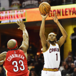 Cleveland Cavaliers guard James Jones (1) shoots over the defense of New Orleans Pelicans forward Dante Cunningham (33) during the second half at Quicken Loans Arena.