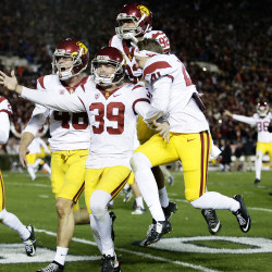 USC placekicker Matt Boermeester (39) celebrates with teammates after making a game-winning, 46-yard field goal as time expired to beat Penn State 52-49 in the Rose Bowl on Monday, Jan. 2, 2017 in Pasadena, California.