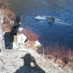 A car driven by Mandi Parker of Jonesboro was submerged in Fox Pond in eastern Hancock County after the vehicle went off Route 182 in this April 2016 photo.