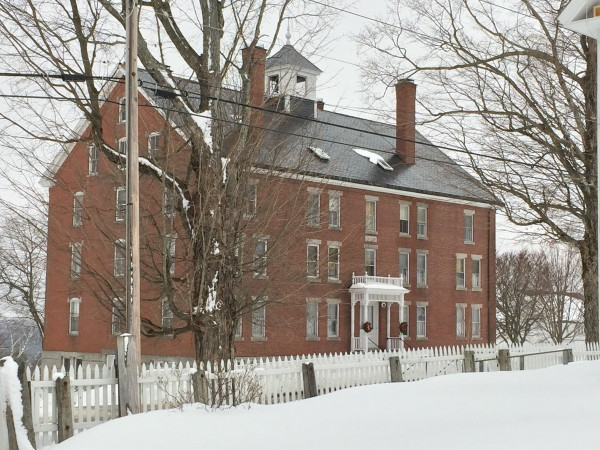 The six-story Dwelling House at Sabbathday Lake Shaker Village, one of 18 buildings on the nearly 1,800-acre site, holds the religious community's meeting room and offices.