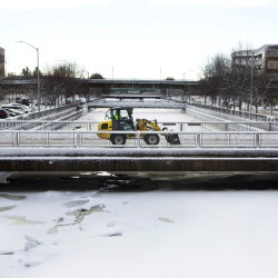 A plow works to remove snow from a bridge in Bangor in this December 2016 file photo.