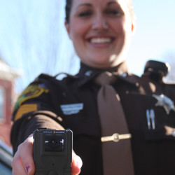 Deputy Erica Pelletier shows off one of the body cameras worn by all members of the Aroostook County Sheriff's Office in this November 2015 file photo. The South Portland police also will start using body cameras.
