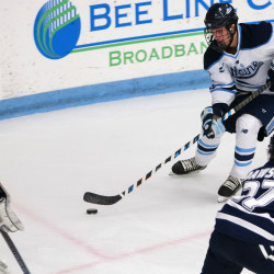 University of Maine's Brendan Robbins (right) looks to shoot past New Hampshire's Danny Tirone during their hockey game on Dec. 3, 2016, at Alfond Arena in Orono.