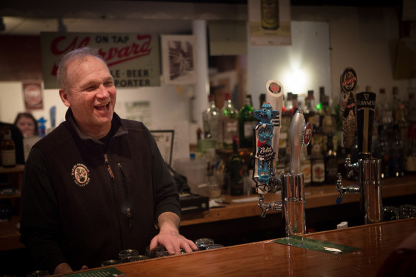 Howie Chadbourne laughs with a customer on Tuesday night at Howie's Pub on Washington Avenue in Portland. Chadbourne is selling his pub and getting out of the business after tending local bars for more than 40 years.