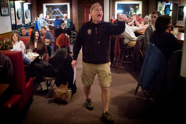 Howie Chadbourne runs the show during the weekly trivia contest on Tuesday night at Howie's Pub on Washington Avenue in Portland. Chadbourne is selling his pub and getting out of the business after tending local bars for more than 40 years.