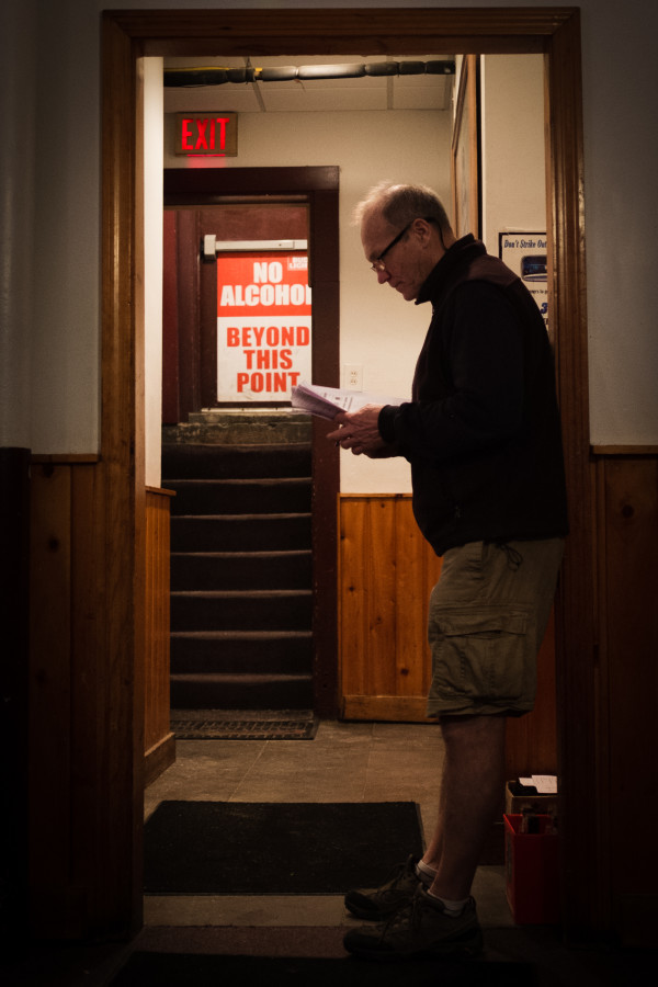 Howie Chadbourne corrects submitted trivia answers on Tuesday night near the back door of Howie's Pub on Washington Avenue in Portland. Chadbourne is selling his pub and getting out of the business after tending local bars for more than 40 years.