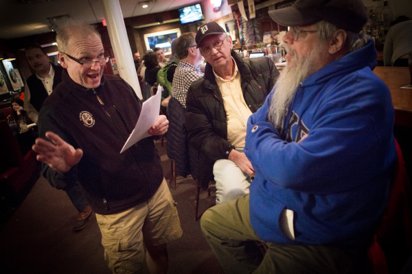 egular trivia contest winners Pat Feury (center) and Gary Libby (right) listen as Howie Chadbourne repeats a few questions on Tuesday night at Howie's Pub on Washington Avenue in Portland. Chadbourne is selling his pub and getting out of the business after tending local bars for more than 40 years.