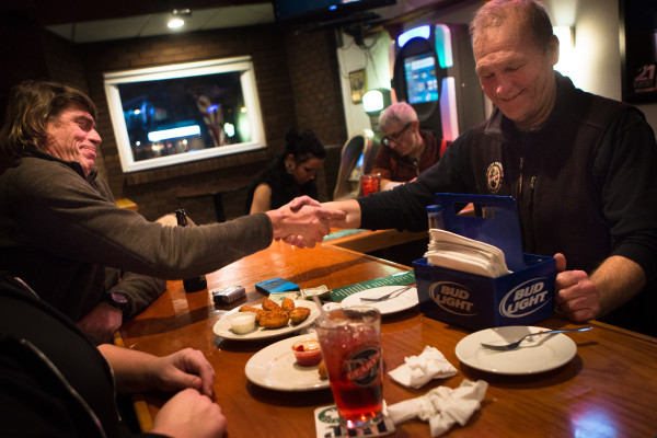 Rob Windsor (left) extends a hand and a &quotthank you&quot to Howie Chadbourne upon learning Chadbourne is selling his pub on Tuesday night at Howie's Pub on Washington Avenue in Portland. Chadbourne is getting out of the business after tending local bars for more than 40 years.