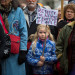 """Eva Beal, 8, of Ellsworth participated a Dakota Access Pipeline protest in West Market Square in Bangor in November. Social justice organizations in Maine are offering """"bystander intervention"""" trainings to deflects and de-escalate harassment and violence against protesters and others."""