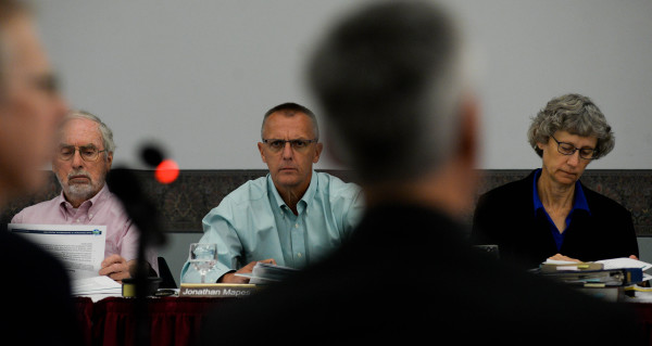 Board of Environmental Protection members Alvin Ahlers (left), Jonathan Mapes (center) and Mary Sauer listen to the testimonies of Jeff Crawford and Mark Stebbins of the Maine Department of Environmental Protection during a public hearing on the third round of DEP mining regulations at the Augusta Civic Center in Augusta in this September 2016 file photo.