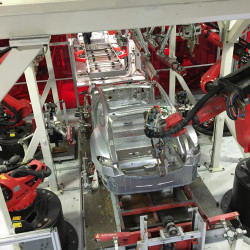 Tesla vehicles are being assembled by robots at Tesla Motors Inc. factory in Fremont, California, in this July 2016 file photo.