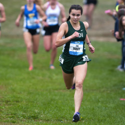 Mount Desert Island's Tia Tardy (right) pulls away from the pack to cross first during the girls seeded race as part of the Maine Cross Country Festival of Champions at Troy Howard Middle School in Belfast on Oct. 1, 2016.